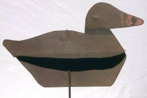 Unusual and Nice metal duck decoy. Has folding wings and good paint