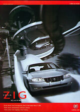 1999 Cadillac Catera - Zig red -  Classic Vintage Advertisement Ad D08