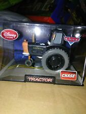 Disney Store Pixar Cars 2 Black Tractor Chase Die Cast in clear plastic display