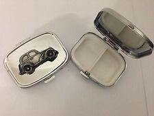 Ford Popular 103 E ref87 pewter effect car emblem on a silver metal pill box