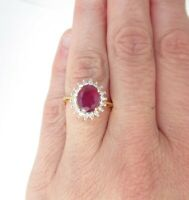 A Fine 18ct Gold Ruby and Diamond Cluster Ring