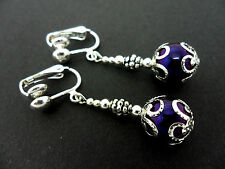 A PAIR OF DANGLY METALLIC PURPLE  BEAD  SILVER PLATED DROP CLIP ON EARRINGS.