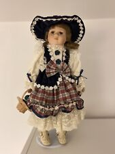 Leonardo Collector's Porcelain Doll Anneka with fruit basket