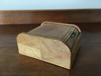 Vintage small wooden box with roll-top lid