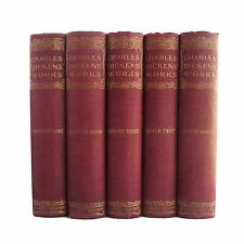 Antiquarian collection of matched hardcover books by Charles Dickens, red cloth