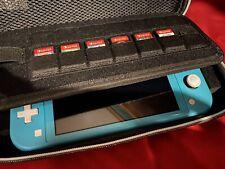 Nintendo Switch Lite w/ 7 games, 32gb Memory Card & Pokemon Carrying Case