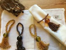 Set of 4 Beaded Napkin Rings with Mounted Bead 'Tassel'. Amber And Green In Bag