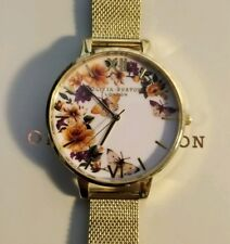 Olivia Burton OB16FS90 Enchanted Garden Gold Plated Watch With 38mm White Face.