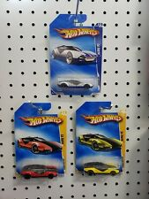 3 Hot Wheels La Fasta: 2009 1 Red and 1 Yellow / 1 2010 Silver Faster Than Ever
