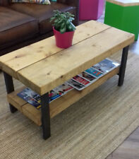 Rustic table in reclaimed timber and industrial steel framed legs