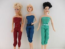 A Set of 3 Satin 1pc Jumpsuits in Bright Colors Made to Fit the Barbie Doll