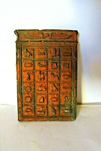 Vintage Icon made of metal, Egyptian Hieroglyphic inscriptions