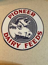 "PIONEER DAIRY FEEDS EMBOSSED 11.75"" ROUND METAL SIGN  NEW"
