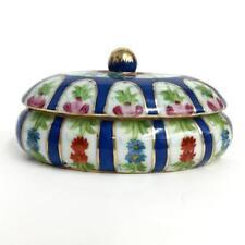 Oval shape porcelain dish with lid embellished with multicolor enamel . Lot 23