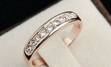 18K ROSE GOLD PLATED AUSTRIAN CRYSTAL ETERNITY RING. SIZE: O