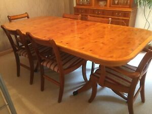 Extending dining table and chairs in Yew wood. Used