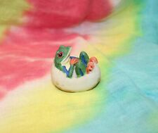 Frog Laying in a Broken Egg Shell Figurine