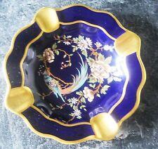 Limoges ,cobalt blue heavily gilded .Central panel enameled  peacock ,camellia,