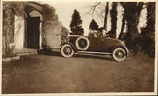 1920s or 30s photo of a car ! great side view with large spare tyre showing !