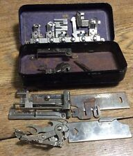 Lot of vintage white Greist /New Home rotary attachments sewing machine