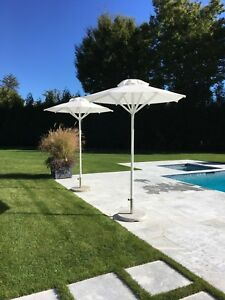 brand new white pool umbrellas, 5 available, in great condition.