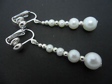 A PAIR OF DANGLY WHITE  GLASS PEARL  SILVER PLATED CLIP ON   EARRINGS.