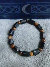 Raw black tourmaline and tigers eye crystal bead healing bracelet root chakra