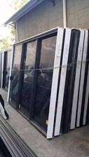Aluminium Sliding Door - 2400h x 2900w Monument Stacker w/ Light Tint Glass