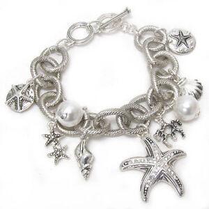 "Silvertone Sealife charm bracelet with toggle closure, 8"""