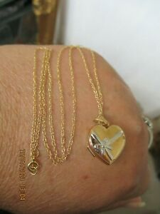 beautiful 9ct white and yellow gold locket necklace fully hallmarked.