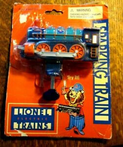 VINTAGE LIONEL ELECTRIC TRAINS SPARKING TIN TRAIN BUBBLE PACK SCHYLLING AS IS