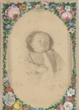 POST MORTEM PHOTO OF BABY GIRL IN EMBROIDERED DRESS -IN COLORED FLOWER FRAME