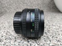 Minolta MD-Rokkor-X  50mm f/1.4 manual focus lens made in Japan.