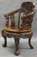 A superb 19th Century Chinese, hardwood Carved arm chair