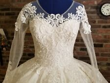Wedding Dresses     Long sleeves, bridal, Size M-L, Veil Included.