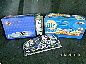 Rusty Wallace 2002 Ford Taurus...1:24...DieCast...Miller Lite/Mobil 1