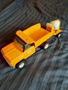 Tonka dump and mixer in orange.