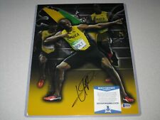 Usain Bolt Jamaica Olympic Gold SIGNED Autograph 11x14 PHOTO Beckett BAS COA 2