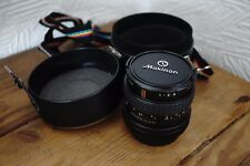 canon fd 28mm f2.8 wide angle lens. case and rainbow strap, makinon, excellent