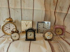 SEVEN VINTAGE WIND UP CLOCKS SWIZA,GLEN,ESTYMA,SALVEST ETC.SPARES OR REPAIR.