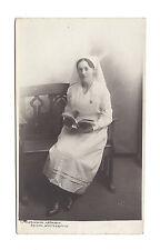 Vintage RP postcard of young nurse in uniform. American Studio, Northampton
