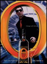Bacardi O orange print ad 2003 Man looking through large O