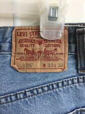 Levis 505 tag size 33x32 MEASURED size 32x30 1/2  blue jeans straight fit (hole)