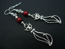 A PAIR OF TIBETAN SILVER  AND RED  BEAD CAT EARRINGS. NEW.