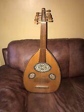 Arabic BOWL BACK MANDOLIN, solid spruce tip, maple binding. At Hobgoblin Music.