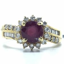 18k yellow gold single stone ruby surrounded by diamonds ring