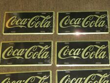 1996 COCA COLA BRAND LOT OF 9 NEW LICENSE PLATES BLACK & GOLD COLORS RARE