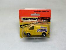 MATCHBOX- #60 FORD TRANSIT-CADBURYS FLAKE-YELLOW- SHORT CARD-1993