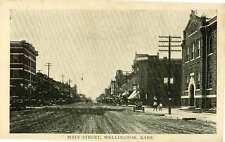 1909 WELLINGTON KS unpaved Main Street postcard
