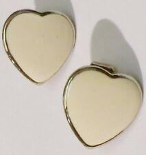 boucles d'oreilles clips bijou vintage coeur couleur argent fond blanc 1780